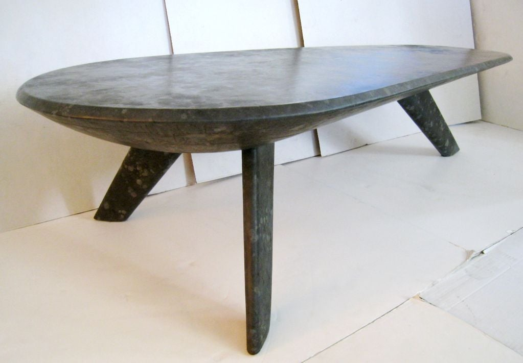 Billy Haines oil drop leather wrapped cocktail table. All surfaces are covered in leather. Original finish. Unusual grey tones. The table is almost 6 foot long. This is an exceptional example of Haines modern work.