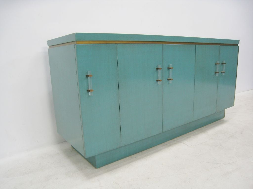 Pair of opposing lacquer cabinets with Lucite handles and brass details. Rear of top surface wired for lamps. Inset marble. New lacquer finish. Overall length 13.5 foot.