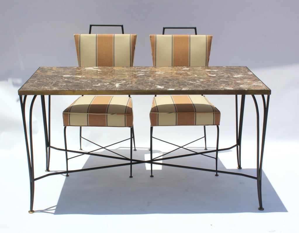 Arturo Pani iron and brass table and chairs. Inset marble top.