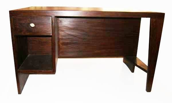 Large Indian rosewood desk with bookcase front and draw on reverse. Modernist leg on right side. Dark red leather top to desk.