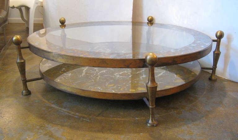 Arturo Pani cocktail table. Solid brass with Églomisé glass on both levels. Executed by Studio Chacon, 1940s.