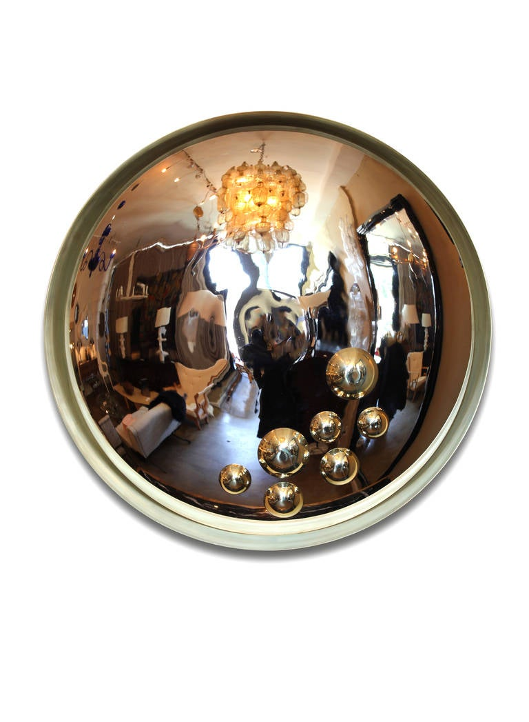 Aspis mirror Inspired by Greek Antiquities Designed by Onik Agaronyan Natural brass frame with chrome convex mirror and polished brass accents