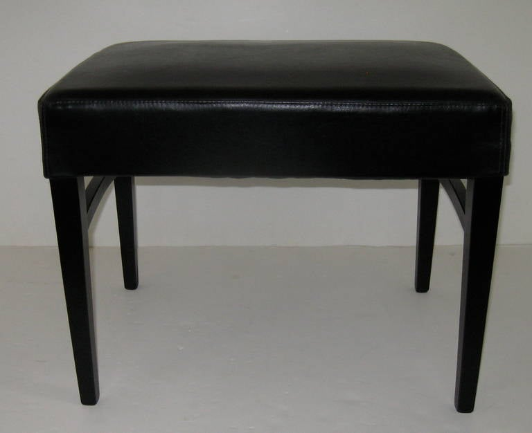Classic pair of benches, newly upholstered in black leather.