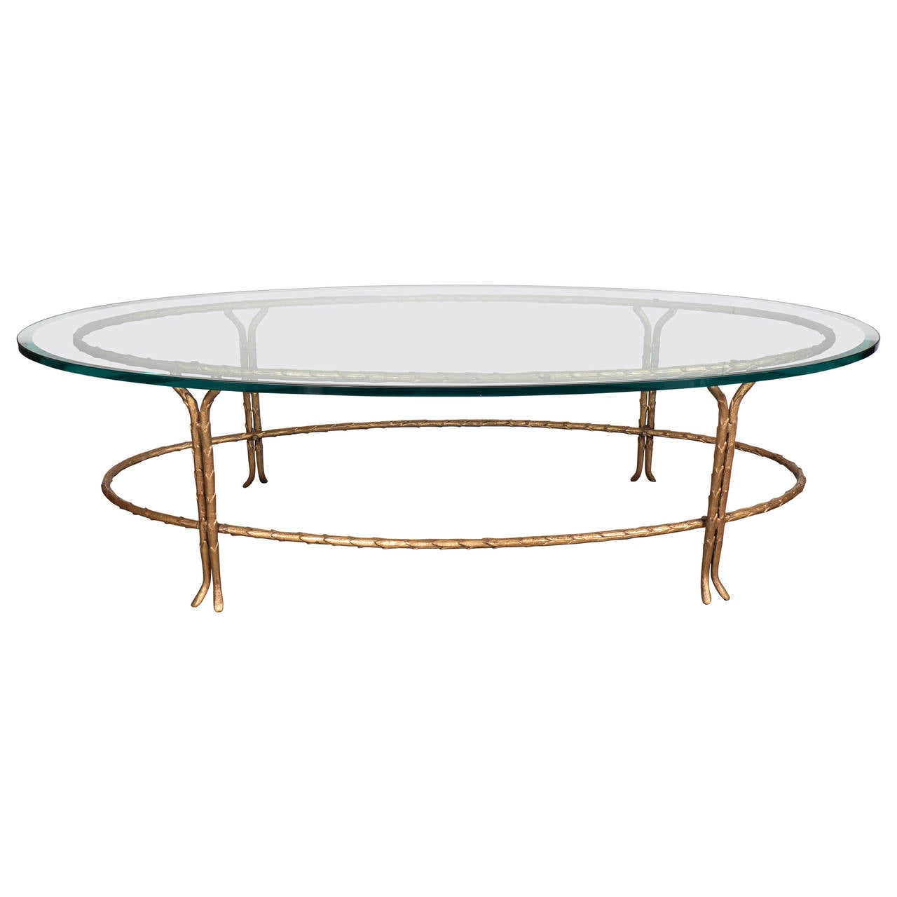 Elegant bagues gilt bronze oval cocktail table with for Oval glass coffee table