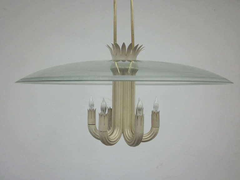 An elegant, sober pendant/chandelier designed by Pietro Chiesa for Fontana Arte in the Post Art Deco / Modern Neoclassical Style (Italian Novecento) with six fluted arms arranged in a circular pattern and covered with a solid glass canopy with an