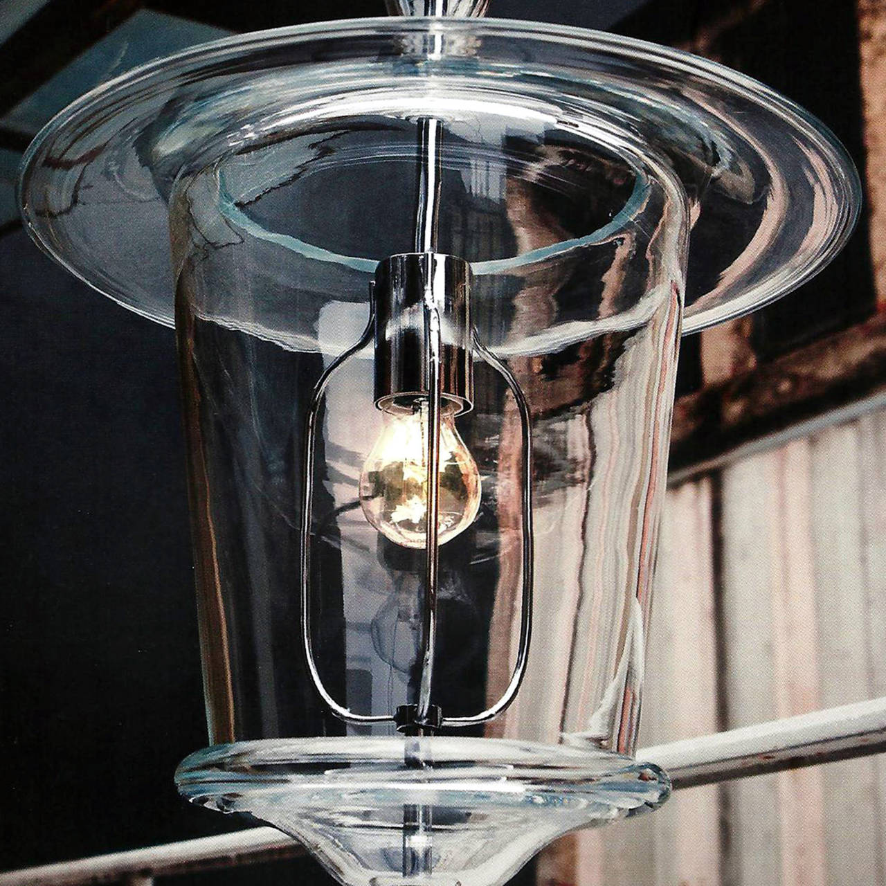 Two pairs of sober, elegant modern neoclassical lanterns or pendants in clear handblown Murano glass.