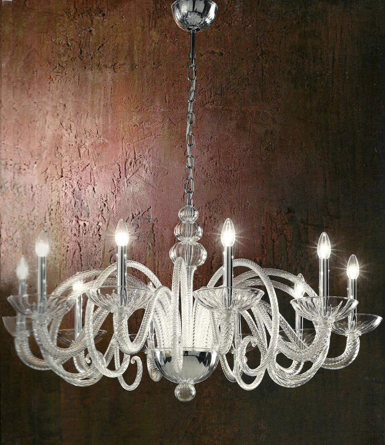 Large Italian Mid-Century Modern Style Handblown Venetian glass chandelier in the style of Barovier e Toso in clear glass and with ten curved spiraling arms.   The chandelier itself (without chain) is 24
