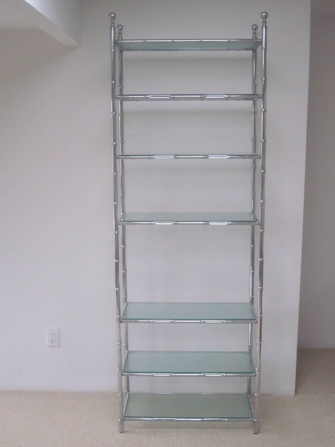 Elegant and practical French Mid-Century nickeled faux bamboo etagere, shelves, storage, bookcase or vitrine in the modern neoclassical tradition with hand worked sand-blasted / frosted glass shelves. Glass shelves can be replaced to suit taste.