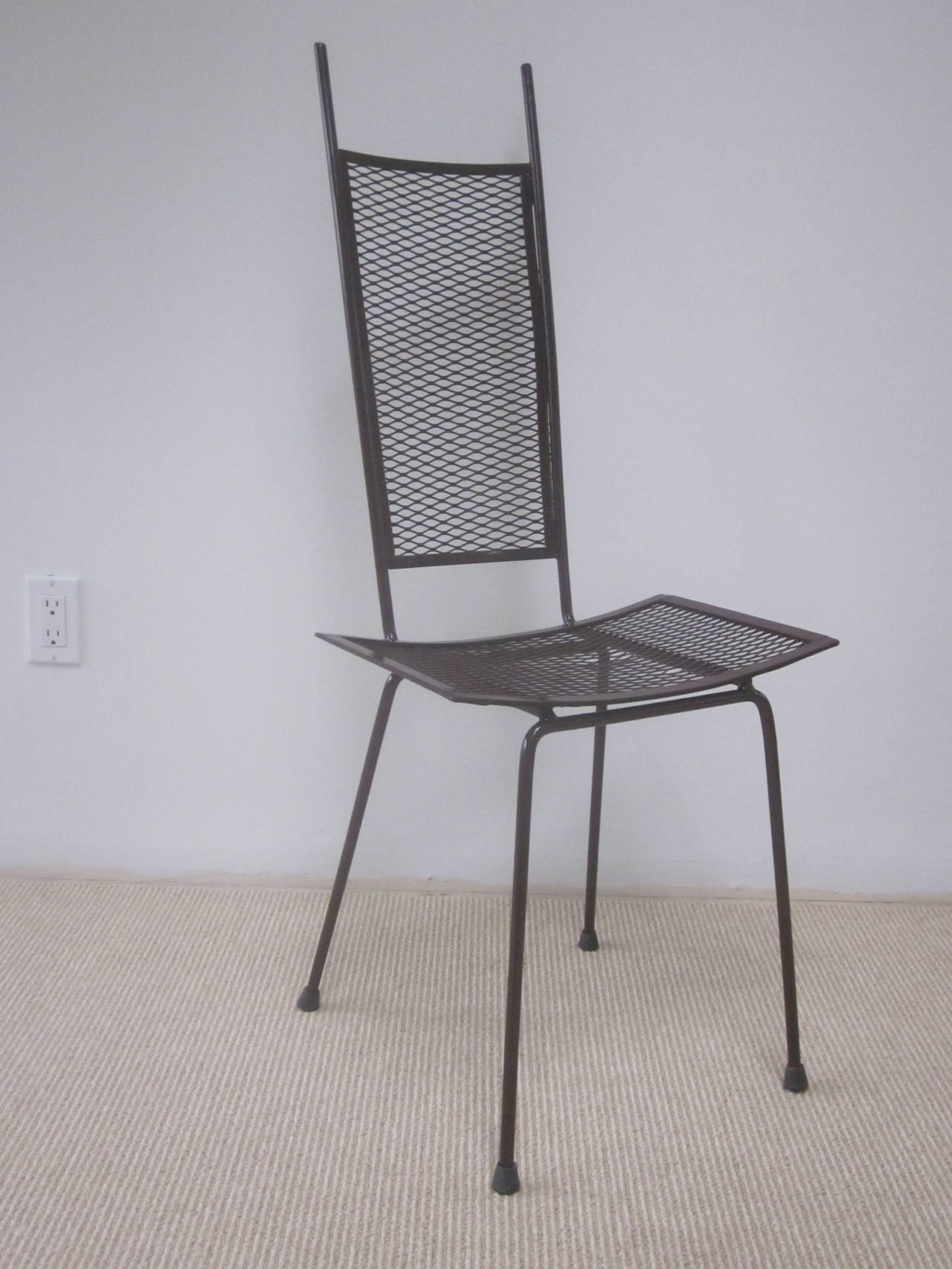 A sober, elegant, handmade Mid-Century Modern side chair in expanded metal showcasing the transparency of it's sleek form and pure lines. Enameled in gloss dark chocolate.