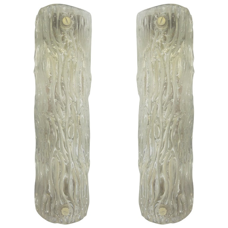 Pair of large, Italian Mid-Century Modern, Venetian glass wall lights or sconces in thick, opaque clear glass in an abstracted tree bark pattern typical of Carlo Scarpa's work for Venini.
