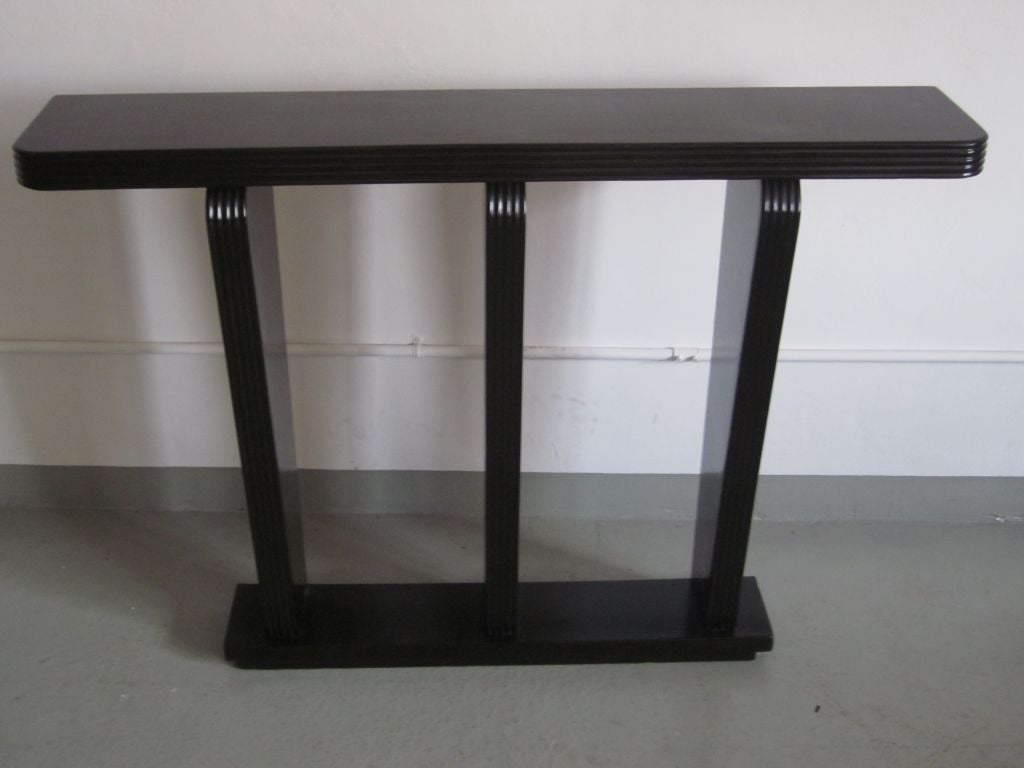 A small Italian Art Deco masterpiece: an elegant, sober console / sofa table with simple, sleek lines cast against a narrow profile and a pure form that embraces neoclassical and modern sensibilities.