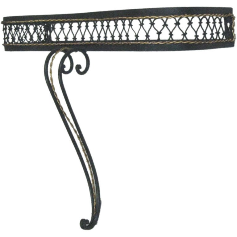 Elegant French Mid-Century wrought iron wall console in the modern neoclassical taste, enameled dark green with gilt banding. Top is a medium grey slate but can be changed if desired.   An accompanying wall mirror is also available.  Height is