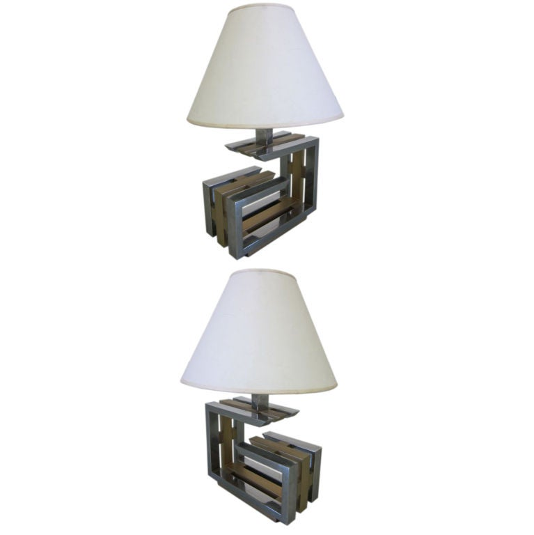 Pair of Italian Mid-Century Modern table lamps in a geometric calligraphy form composed of nickel and brass by Romeo Rega.