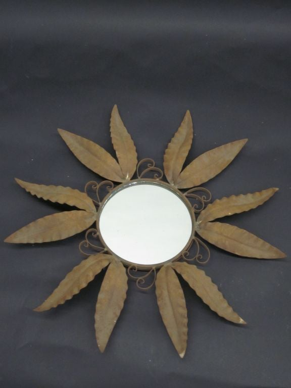 Chic pair of French Mid-Century wrought iron mirrors in the form of sun burst/star/starburst.