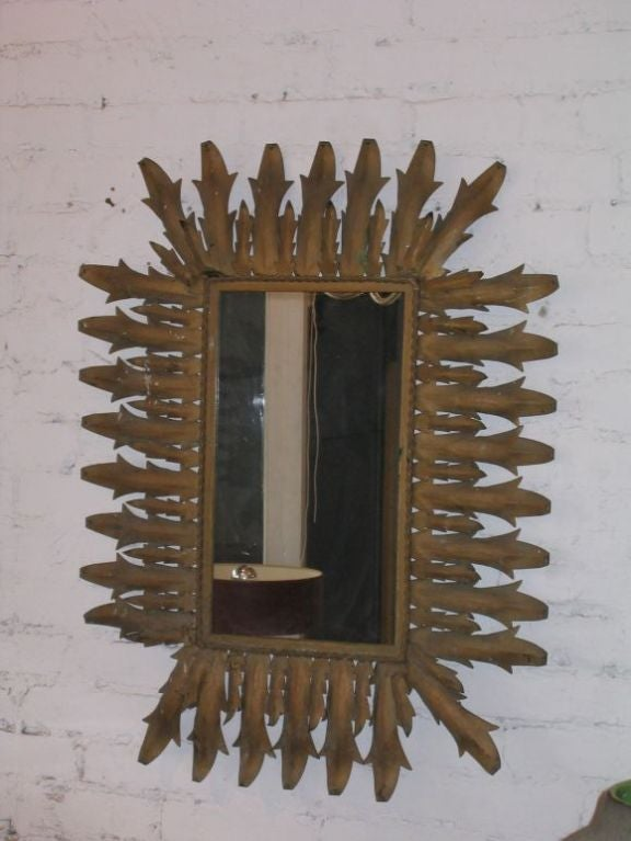 French 1940s gilt iron rectangular wall mirror in the form a sunburst
