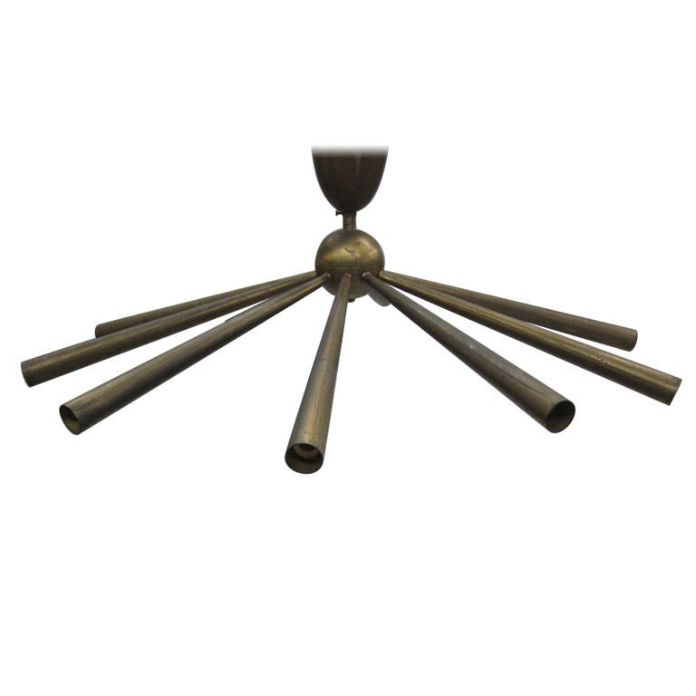 Sober, modern neoclassical antique solid brass chandelier / pendant in the form a sunburst with ten arms. Can be suspended to desired height or flush mounted.