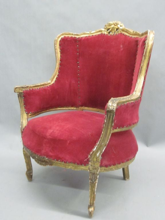 20th Century Pair of Louis XIV Style Italian Gilt Wood Wing Back Lounge Chairs, 1930 For Sale