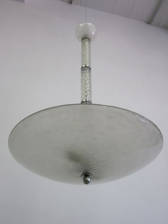 Elegant Italian Modern Neoclassical clear blown glass pendant / chandelier by Barovier with a large clear bubbled blown glass disc/bowl.   The fixture has 3 8