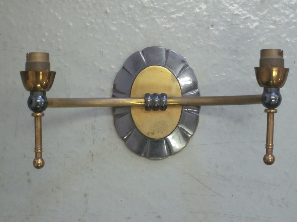 A pair of French double arm modern neoclassical wall lights.  The pieces can rewired to specification.