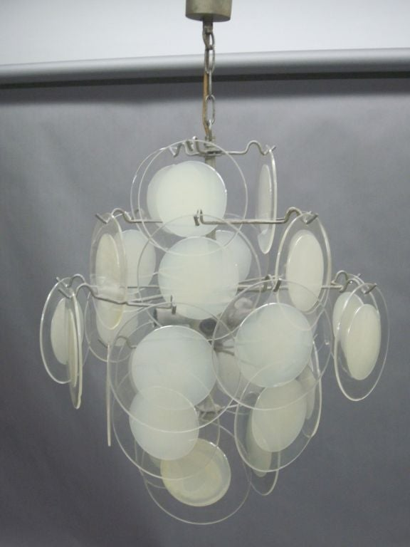 Mid-Century Modern chandelier, pendant of fixture by Vistosi utilizing clear acrylic discs with white centers as reflectors. 
