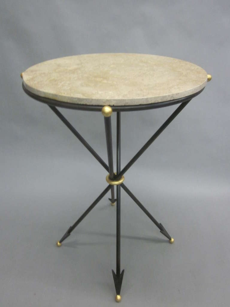 Elegant Pair of mid-century modern neoclassical, French, 1940s style end tables/ gueridons in partially gilt wrought iron with arrow finial motifs and stone tops.   In the style of Maison Jansen.  Priced as a pair but can be purchased individually