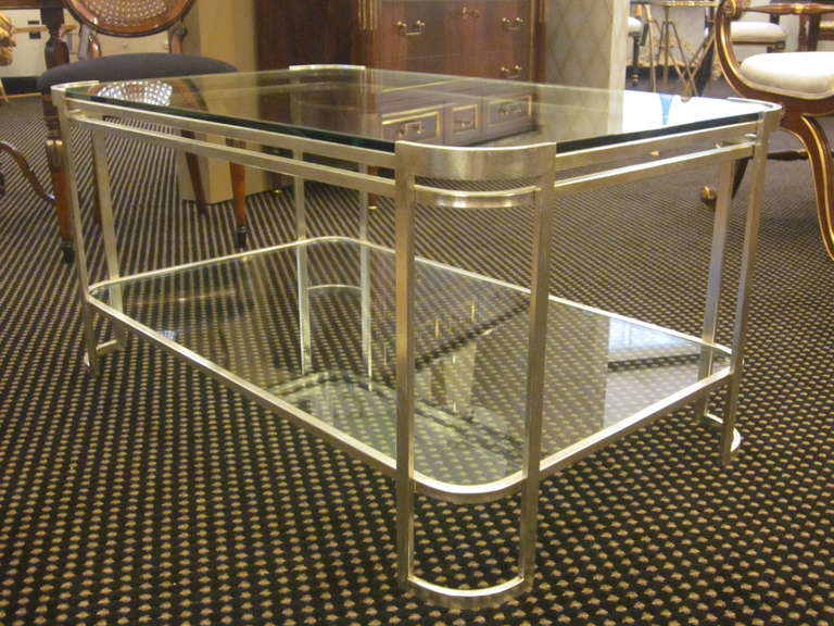 Elegant Italian, Mid-Century style, silver leafed double level cocktail table embracing neoclassical and modern traditions.