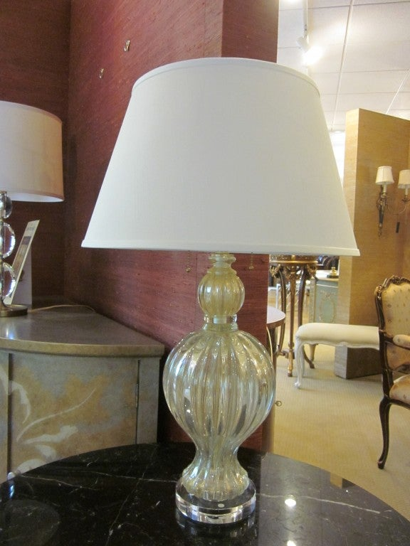 Pair of elegant, Italian Mid-Century Modern style handblown Murano glass table lamps in a subtle mixture of white, gold and clear glass. The lamps are shaped in the form of balusters and rest on clear glass bases.  UL wired for 2 lights at 60 watts