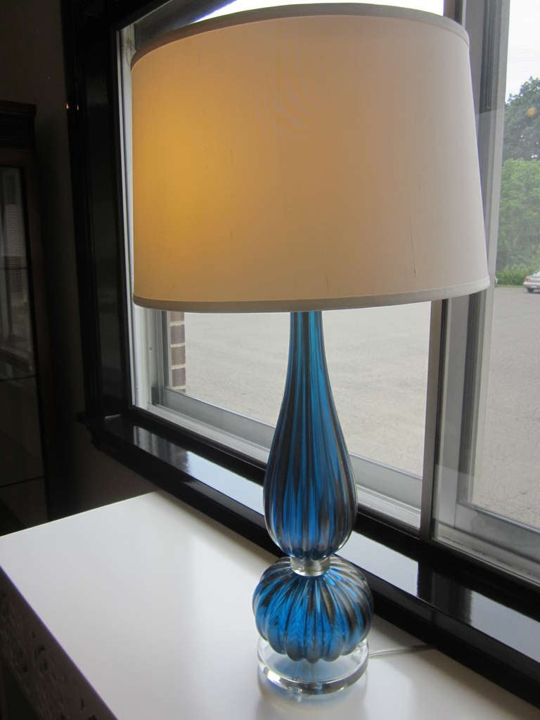 2 Pairs of Italian Mid-Century, Hand Blown Venetian Glass Table Lamps in the Modern Neoclassical Tradition with Aqua Colored Glass and Gold Highlights. These Lamps Present Dramatic, yet Subtle Refined Coloration and Rest on Clear Hand Blown Glass