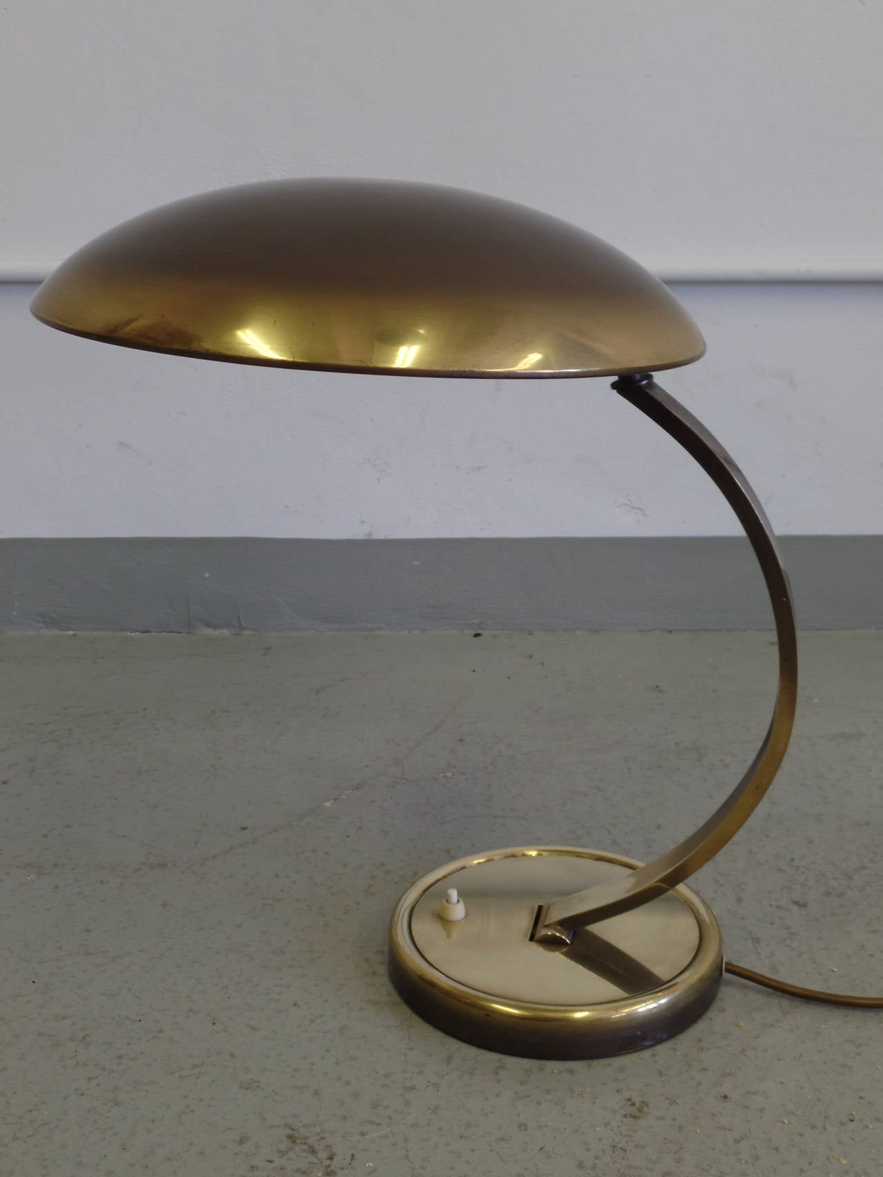 German 'Bauhaus' desk lamp in solid brass designed in the 1930 period and attributed to Hillebrand. Stabile, practical and fully adjustable; the lamp stem and shade both articulate.