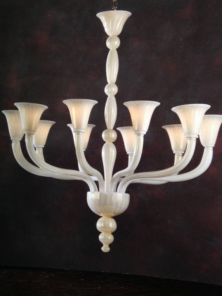 2 Italian Mid-Century style hand blown Venetian glass chandeliers or pendants in milky white glass with  gold flecks, with ten arms, in the modern neoclassical tradition.   Priced and sold individually. The height of the piece without chain and