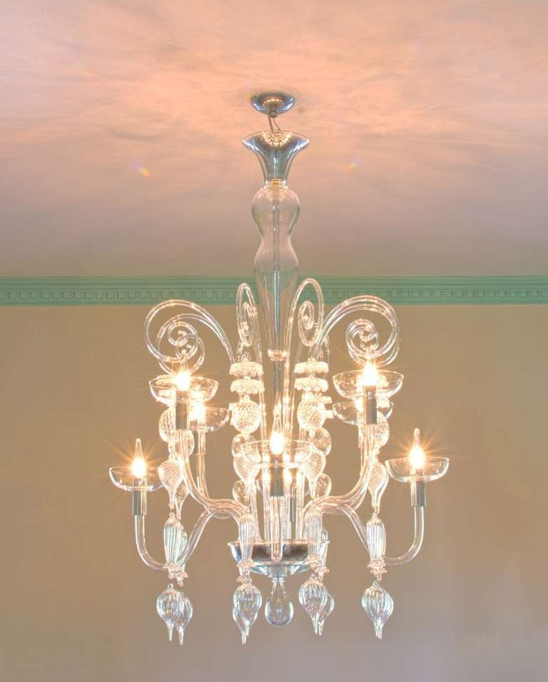 A Delicate Hand Blown Clear Murano Glass Chandelier in the Modern Neoclassical Tradition Designed by Carlo Scarpa for Venini (from the 99.37 Series) circa 1930-40 with 8 Arms and Chrome Details. UL Wired for US standards.