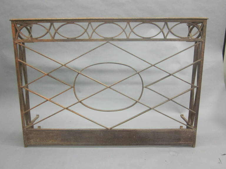 Elegant French hand-hammered wrought iron console in the neoclassical tradition with intersecting diamond form designs and X-form designs.  Stone top is not shown.  References: Napoleon III,