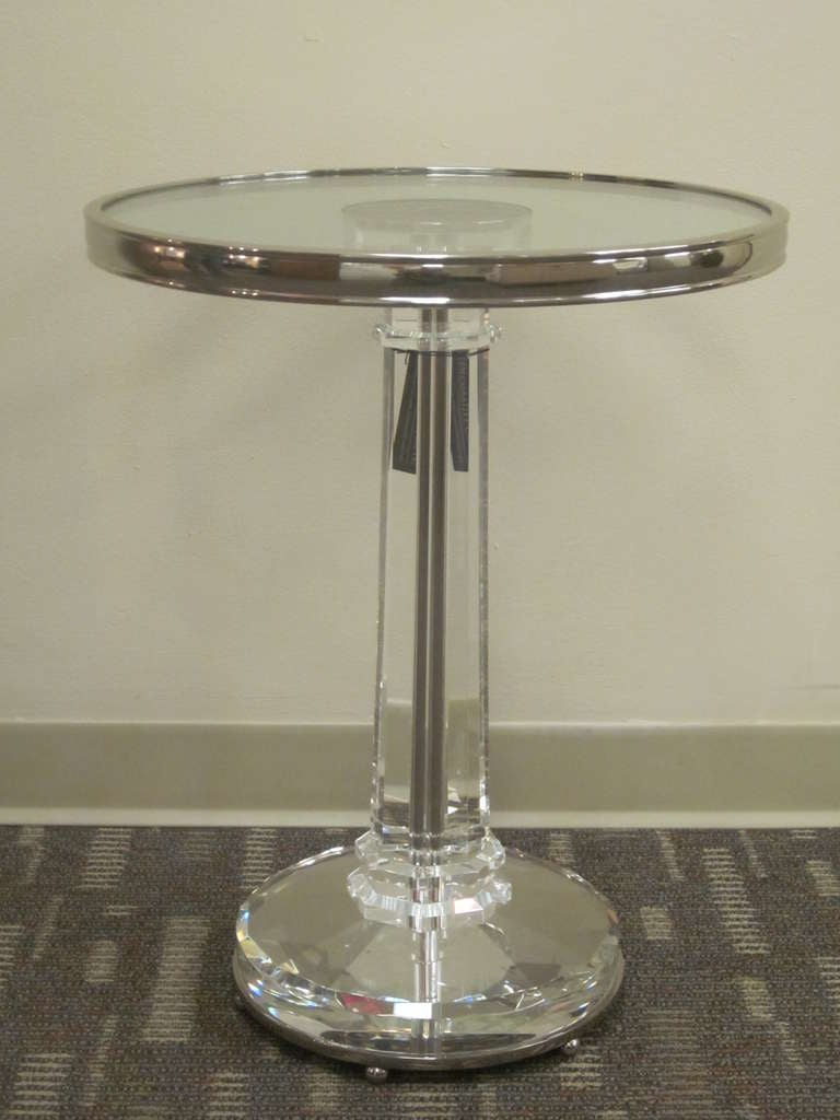 Elegant pair of Italian Mid-Century style end tables in the Modern Neoclassical spirit. The pieces are of rare quality in polished nickel-plated brass and with cut, solid lead crystal pedestal, stem and top.   Referenecs: Style of Baccarat, Fontana
