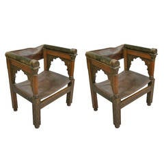 Four Franco-Islamic Carved Wood and Leather Lounge Chairs