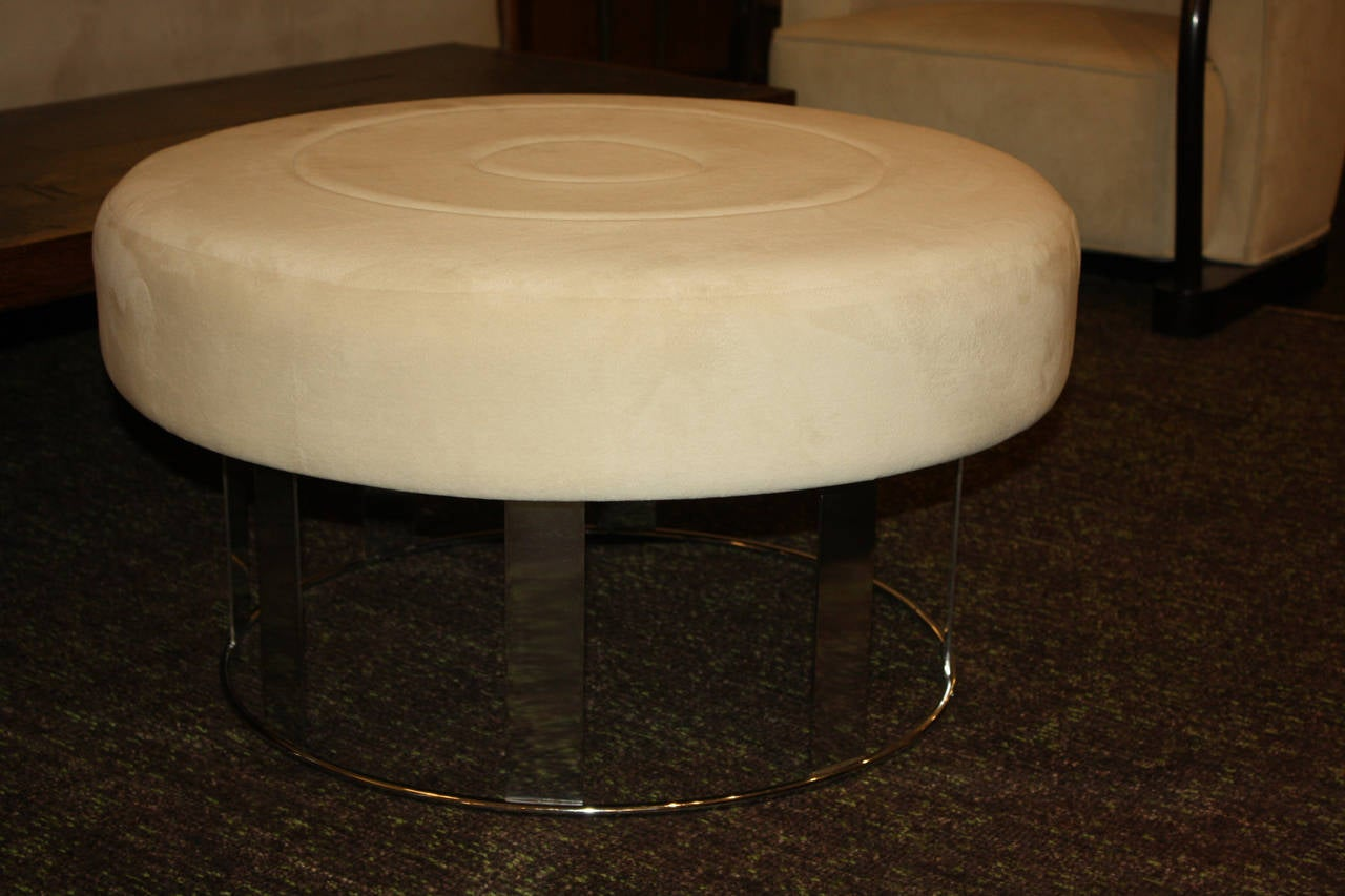 Pair of round ottomans plated in nickel. Top stitched seat.