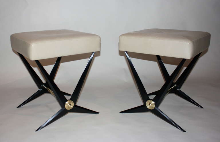 Jacques Tournus benches cast aluminium in black enamel base, iron and brass, with leather seat.