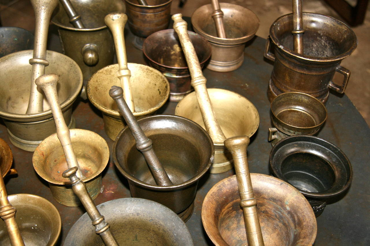 Mid-20th Century Collection of 17 Pharmacy Mortar and Pestles For Sale
