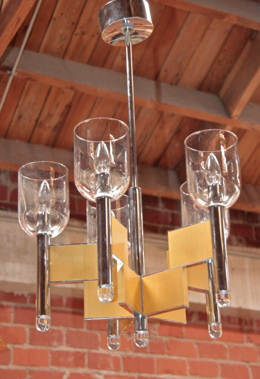 Smaller scale Sciolari chandelier. (try saying that one fast...)<br /> <br /> Wonderful for a small space.