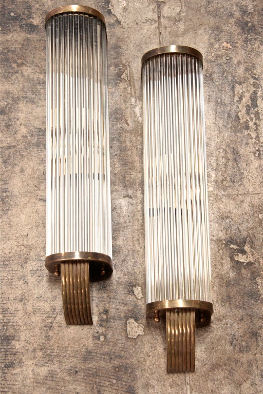 Long tubes of connecting glass and brass make for lovely linear lighting.