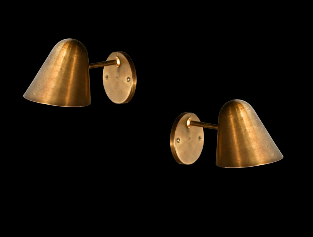 Pair of sconces with pivoting shade for light direction
