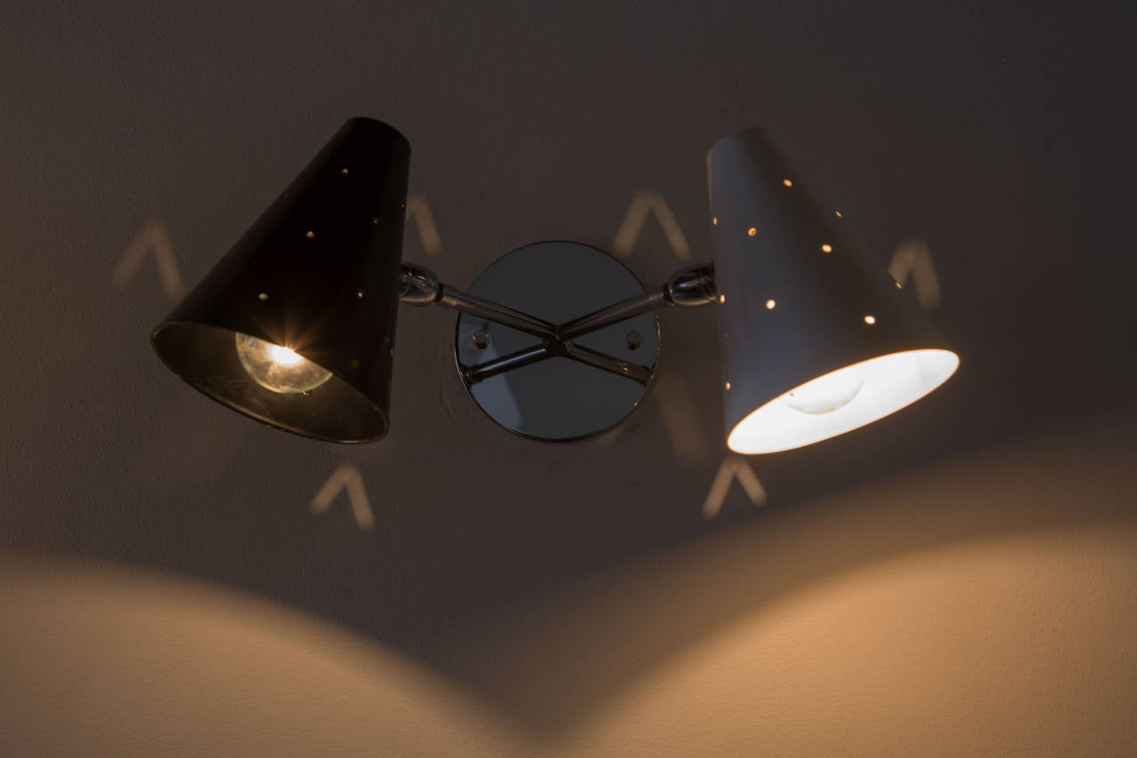 Double shade pivoting ball joint sconces, perforated shades.