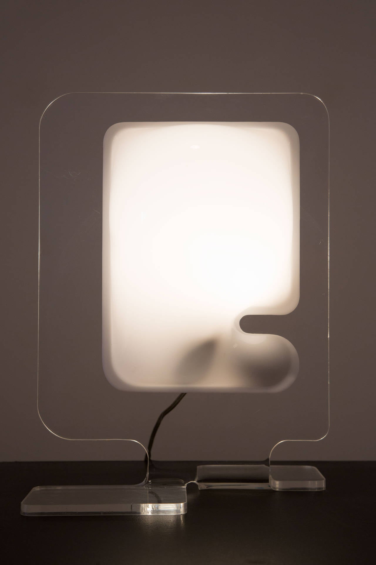 A laser cut acrylic table lamp  by Boris Tabacoff for Pierre Cardin.