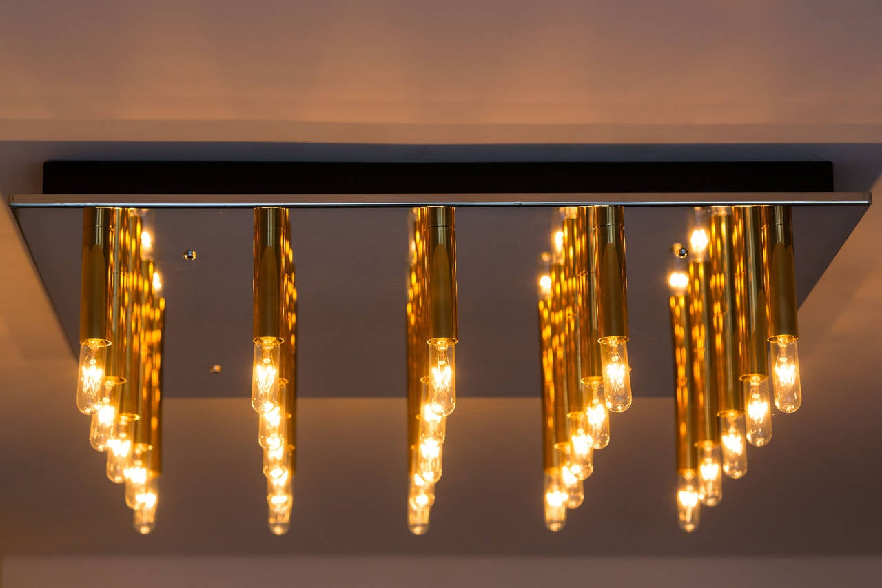 Flush mount ceiling light of polished steel and brass sockets. Can be used in multiples for large-scale projects.