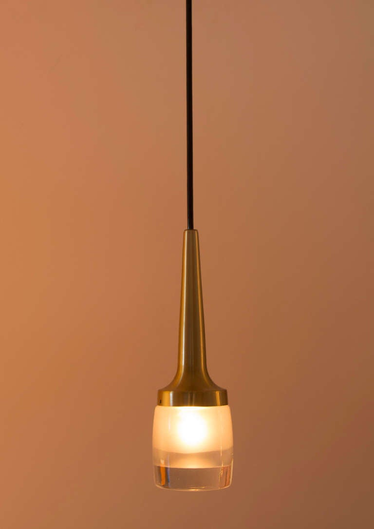 German staff pendants with mold blown glass diffuser.
