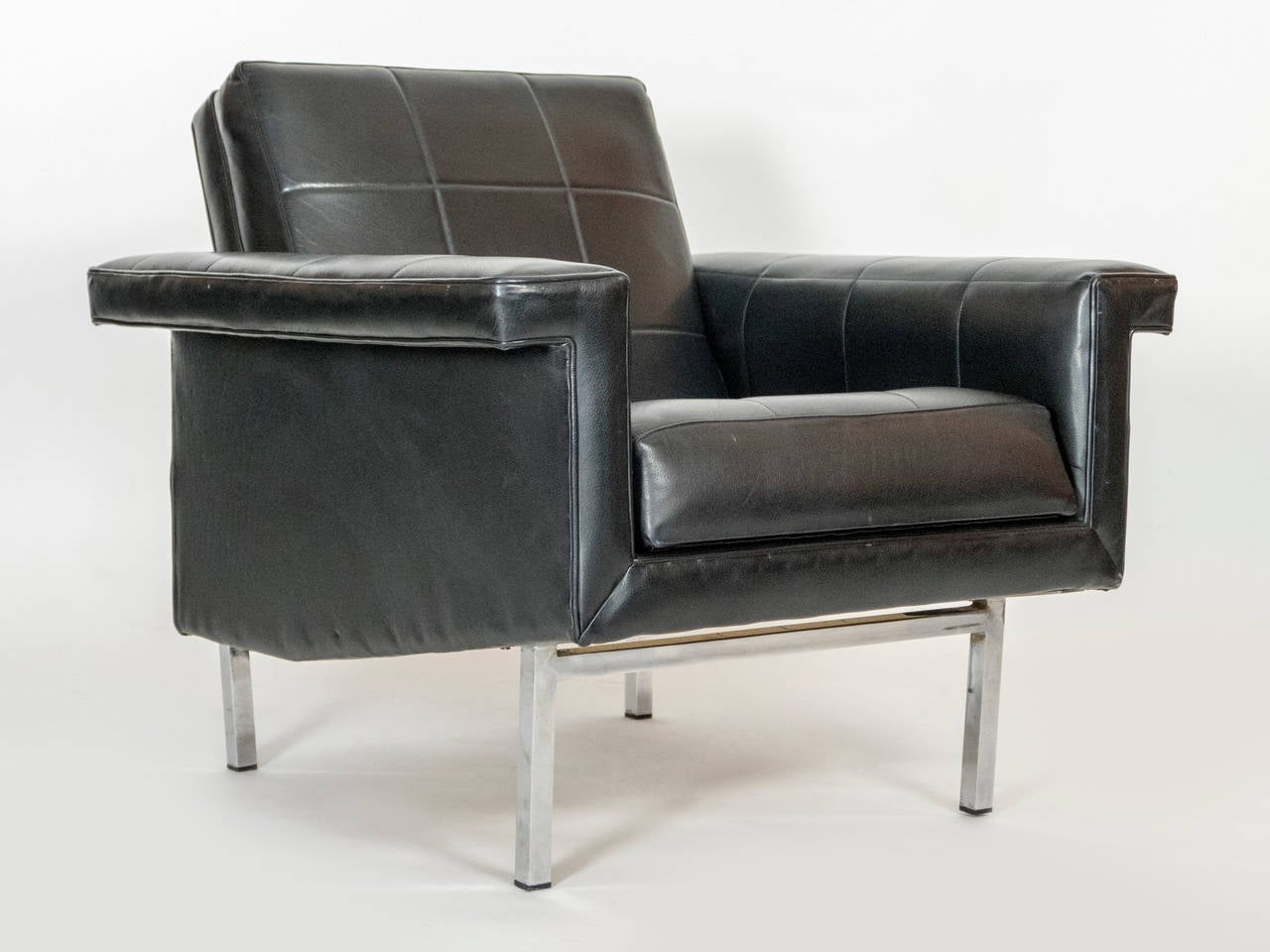 Two vintage condition armchairs,  Super inviting and comfortable. The lines of the chairs are very stylish.   Original leather in great shape.   Chrome has a nice patina for the age proving its authenticity.