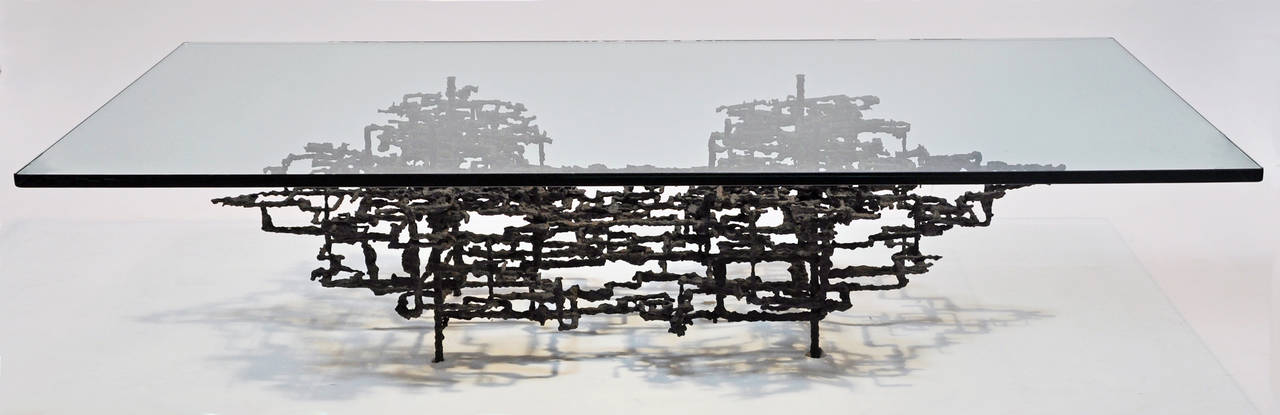 Outstanding modernist welded steel and glass coffee table. Measure: Abstract metal base with 3/4
