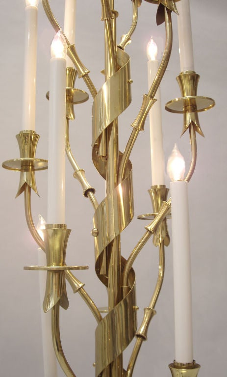 Pair of brass and marble floor lamps made by Stilnovo. Impressed with Made in Italy,  Features ten lights on one and twelve lights on the other. Top quality design and construction. Price is for the pair.