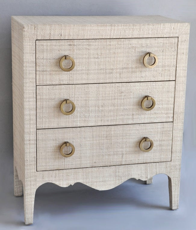 Three drawer grass cloth covered dresser or night stand, with brass pulls.