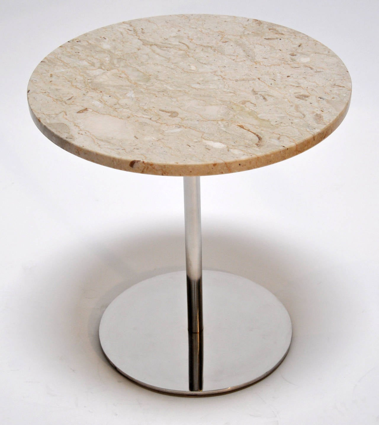 Marble and polished steel side tables. Top quality design and construction. These are heavy and solid. Price is for the pair.