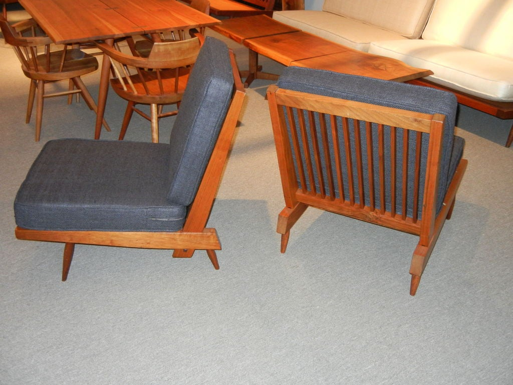 A classic Nakashima chair in American black walnut with charcoal silk cushions. Provenance available. Price is for pair. 2 Pair available.